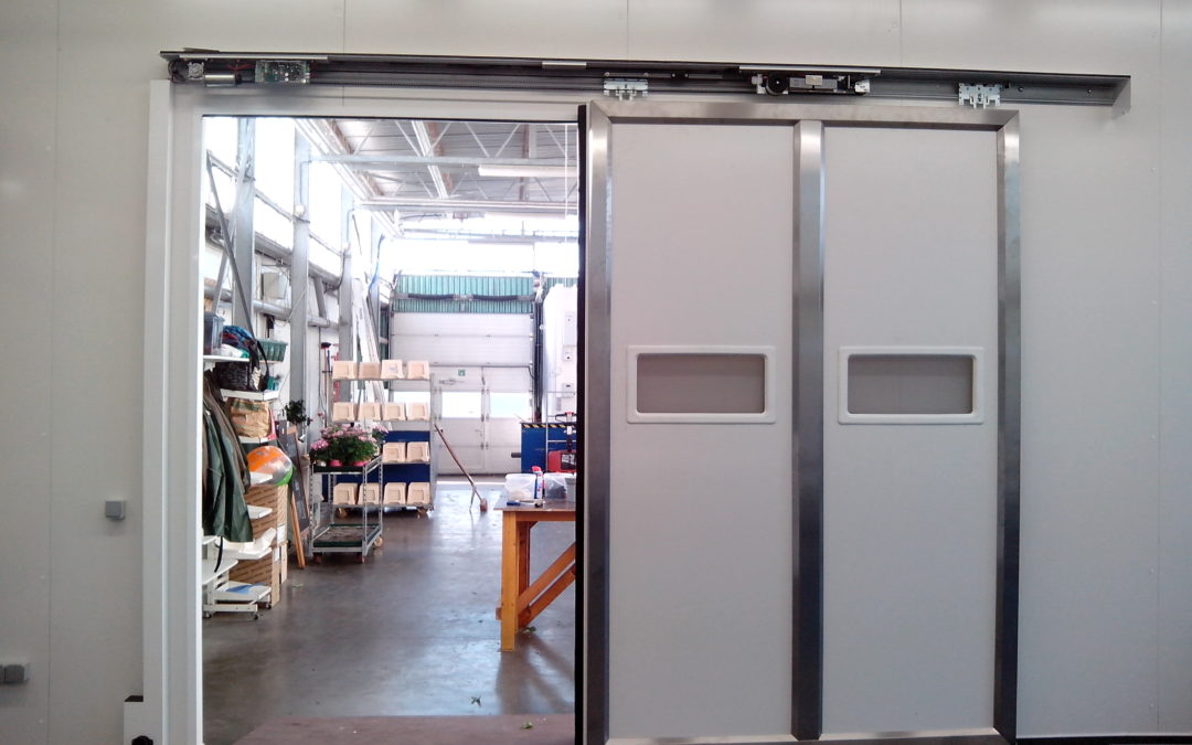 Insulated automatic doors for heavy use, Alken, Belgium